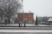 Pedestrians make their way through the snow in Knutsford today.