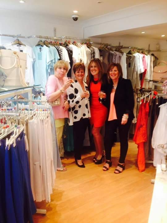 Delia Metcalfe and guests enjoy a glass of champagne at the opening of the new King Street store