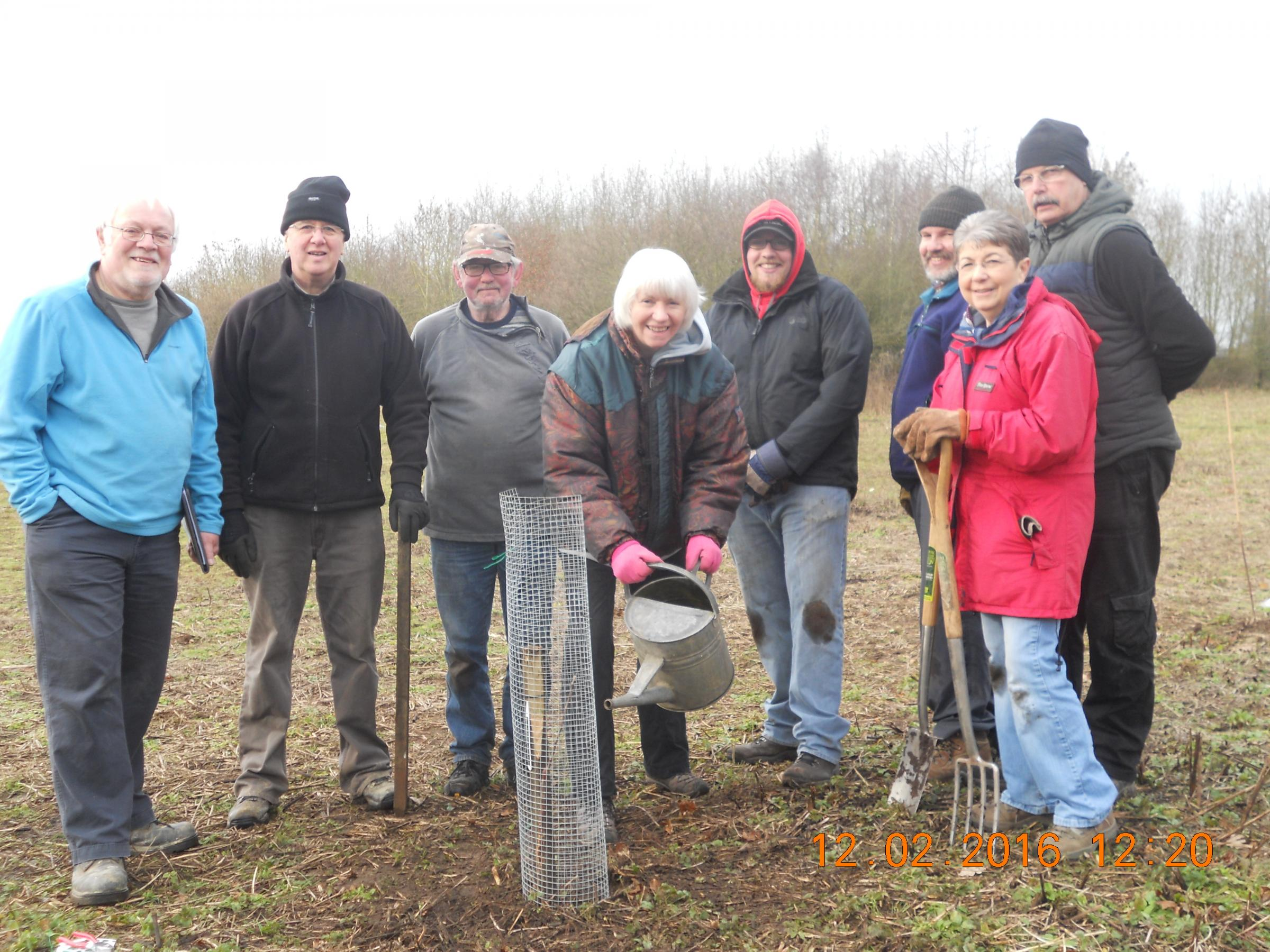 Some of the volunteers around the first Wareham russet planted in the Community Memorial Orchard
