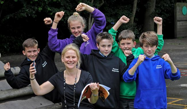 Peover Superior Primary School, Over Peover. School had a terrible report two years ago, results at 20 per cent pass rate, pupils pulled out, now had great success in KS2 exams. pictured is head Lisa hesmondhalgh with, from left, Johnny Ardern, Hannah Cla