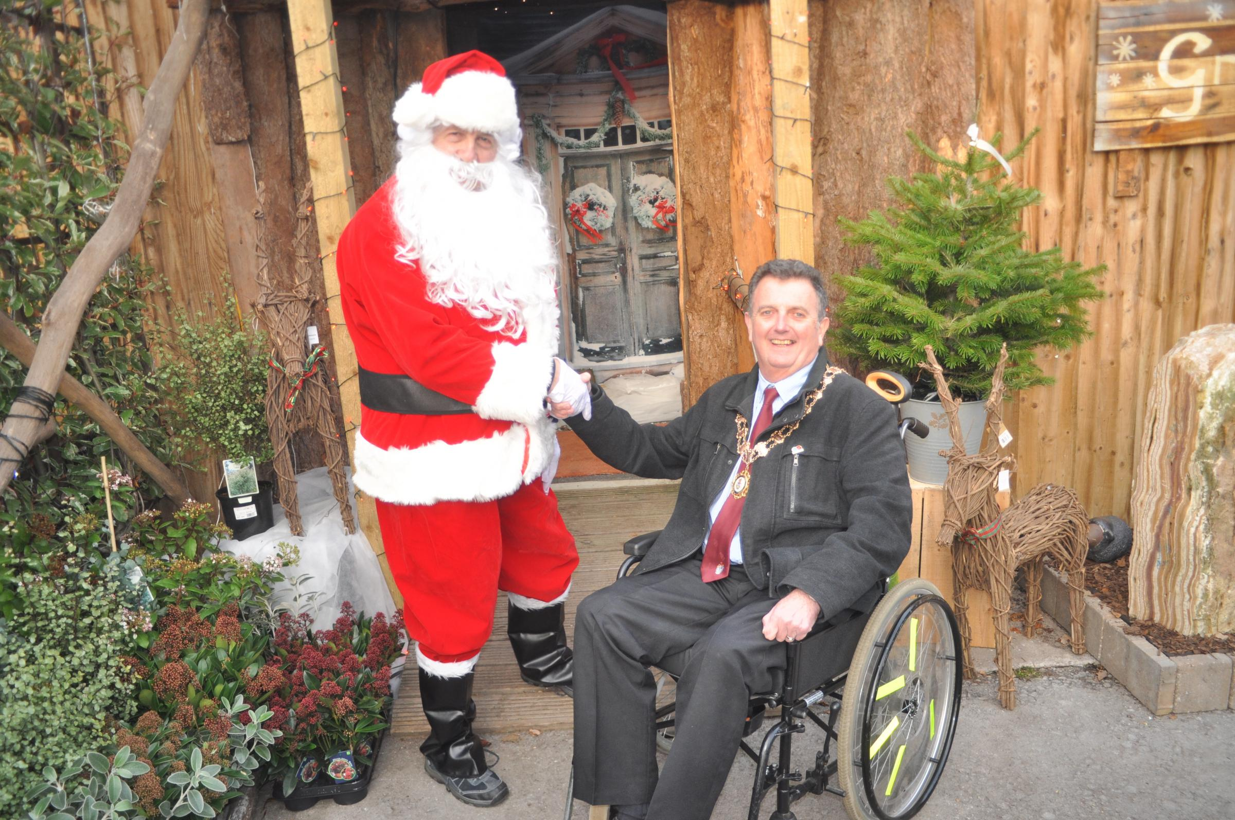 Knutsford town mayor Cllr Neil Forbes meets Father Christmas at the grotto