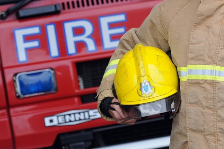 Firefighters help remove vehicle after crashing into house in Chelford