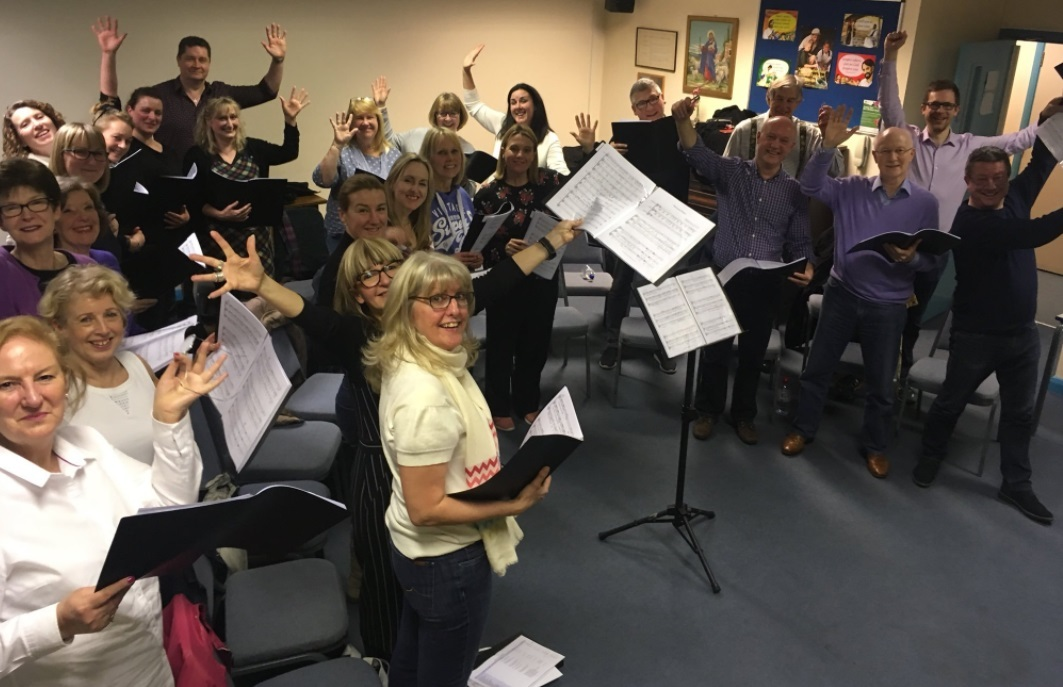 Members of the choir rehearse for the May 12 fundraiser