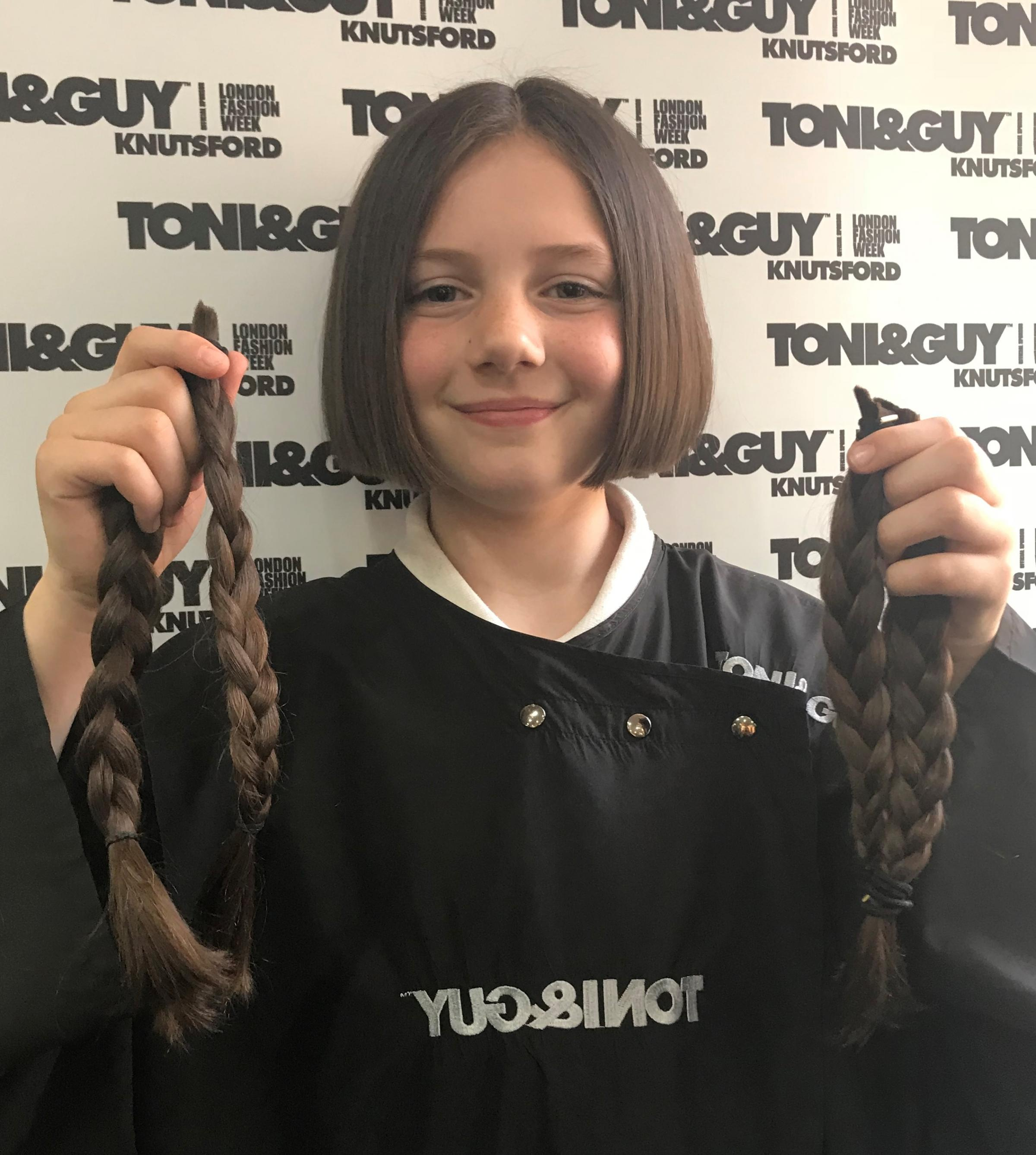 Lydia shows off her new hairstyle and donated locks