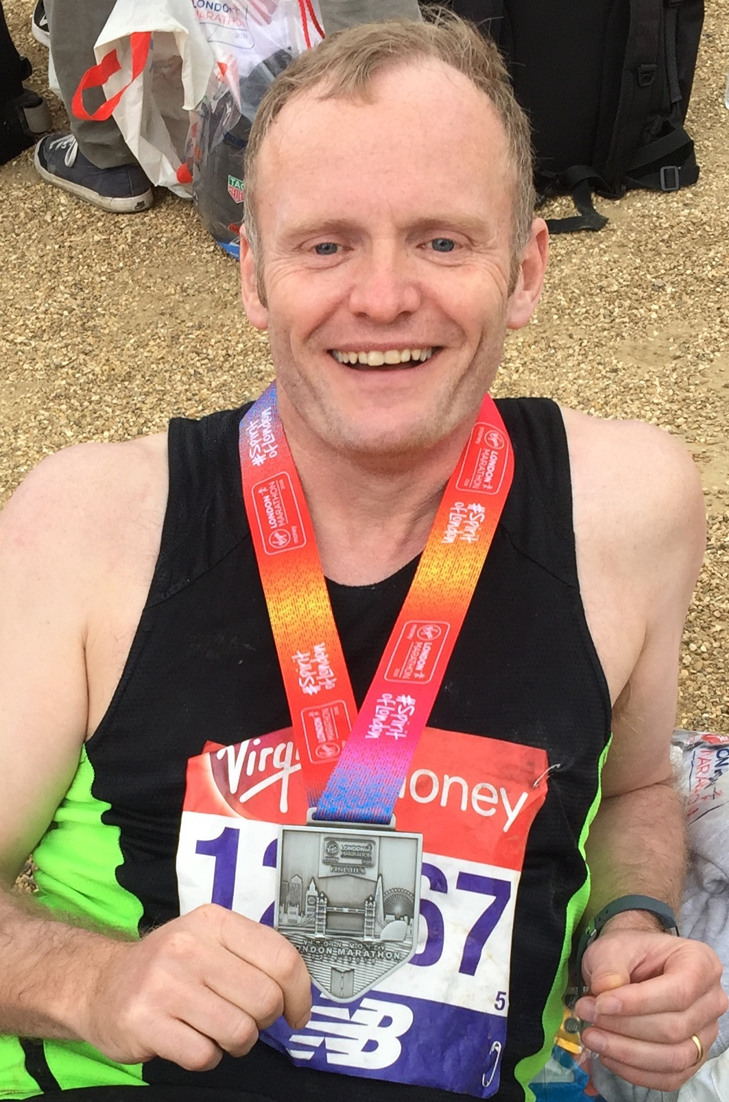 Chris Green shows off his London Marathon medal