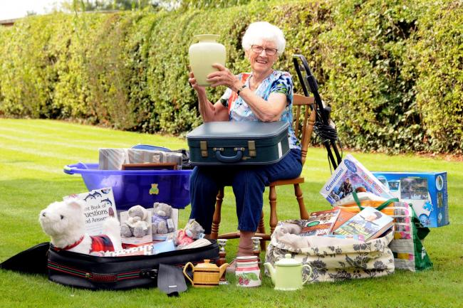 Barbara with some of the items to feature at Saturday's jumble sale