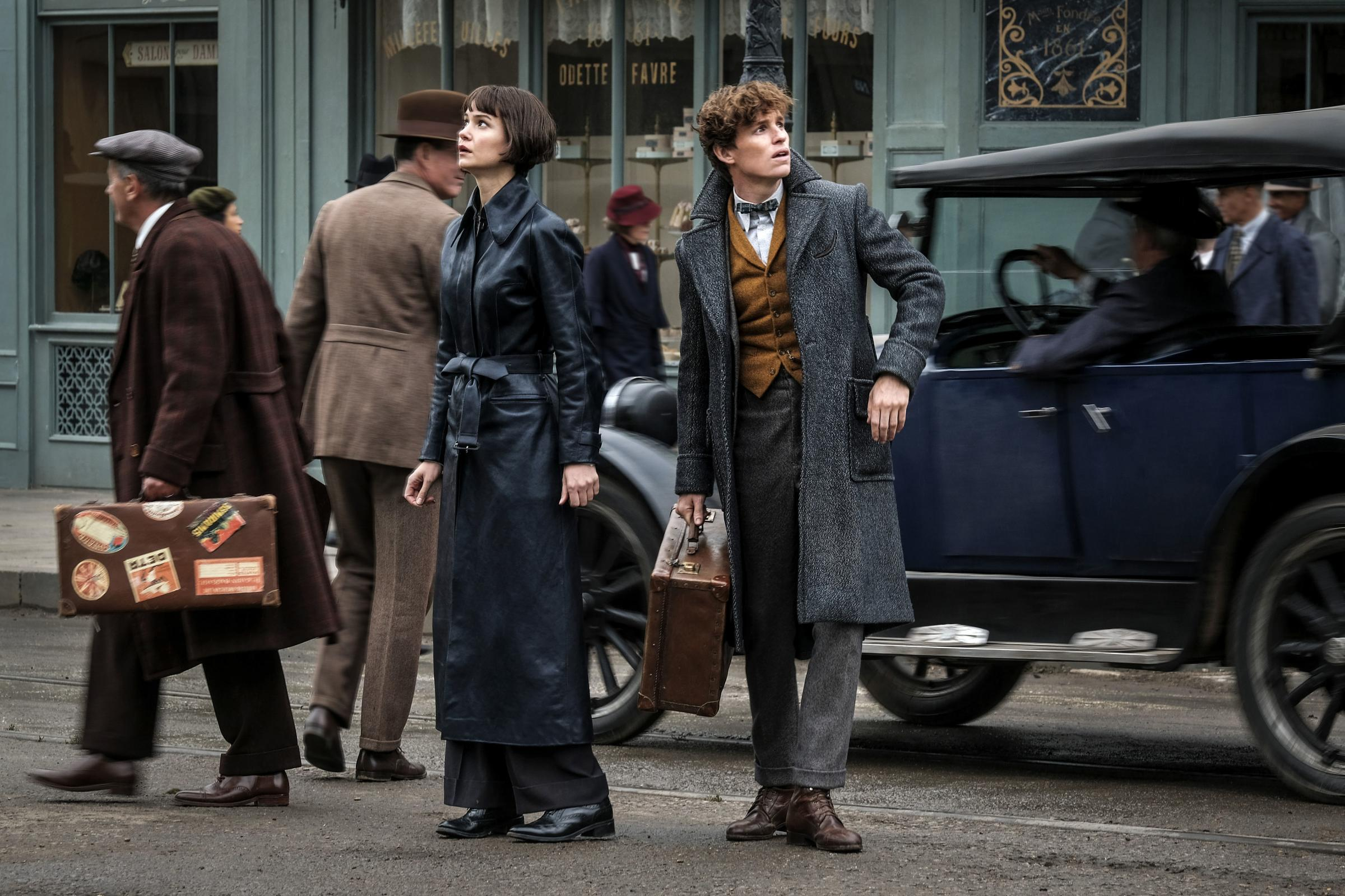 Katherine Waterston as Tina Goldstein and Eddie Redmayne as Newt Scamander