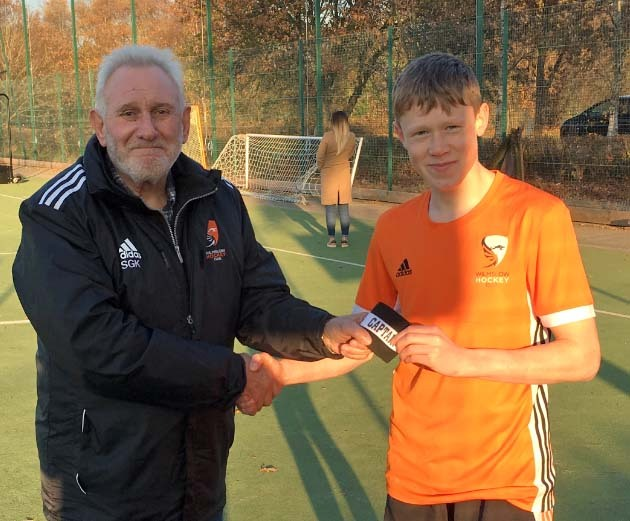 Wilmslow Hockey Club men's team 16-year-old Tom Davenport receives the captain's armband from club president Steve Kinsella