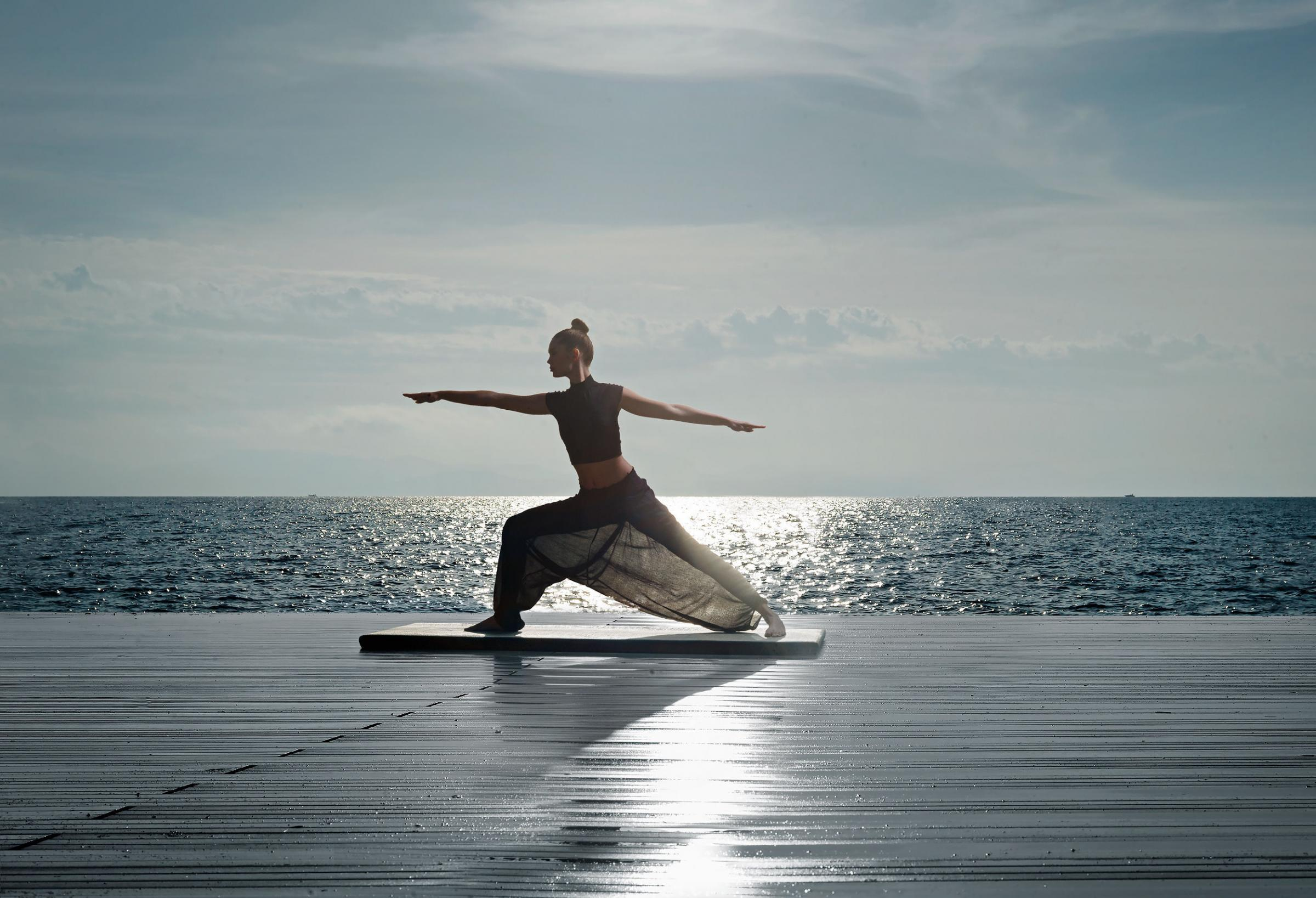 Yoga on the beach at Divani Apollon Palace and Thalasso in Greece