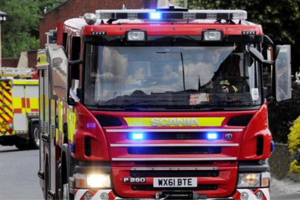 Combine harvester fire at farm in Wilmslow