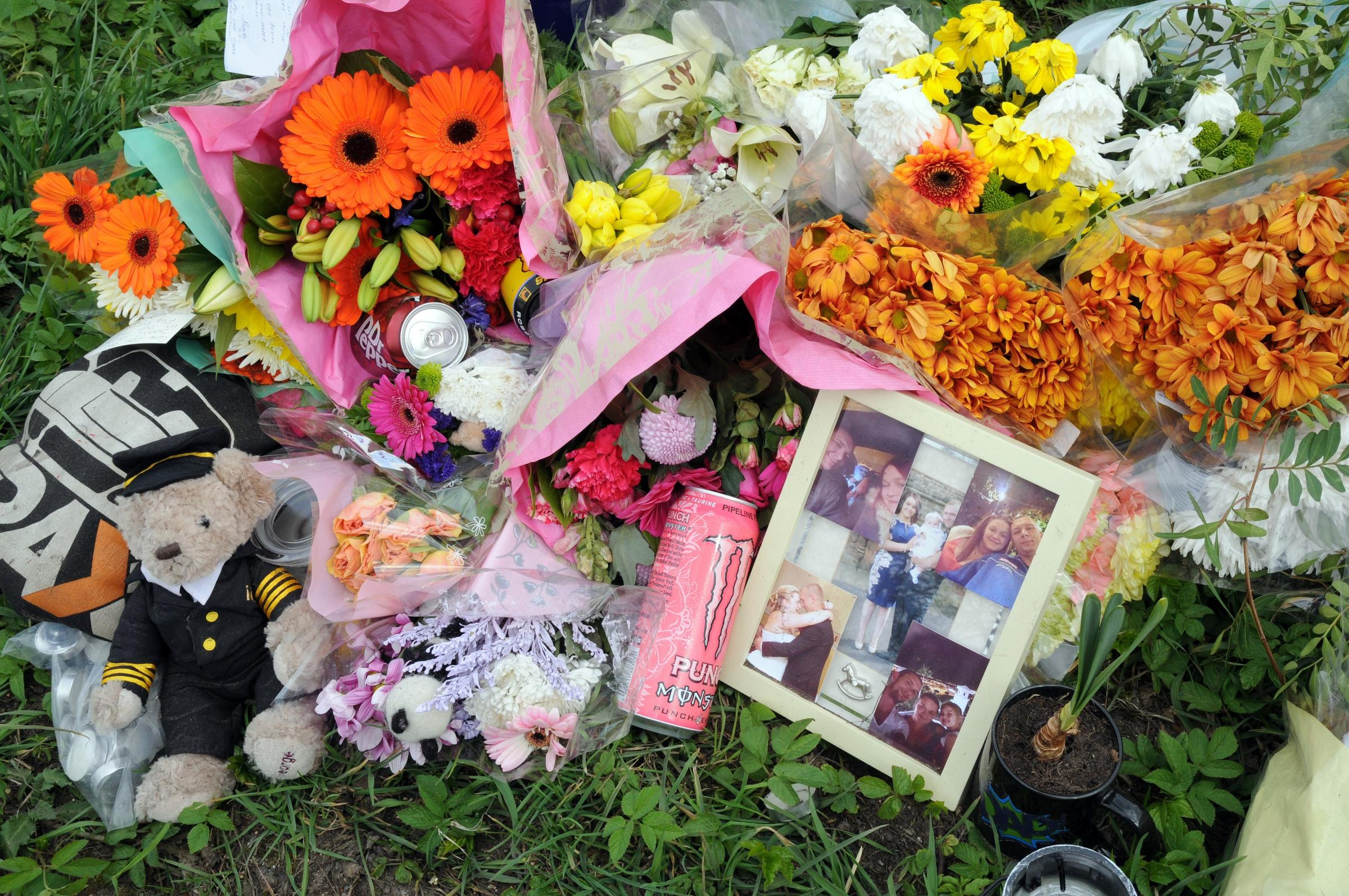Floral tributes left at the scene of last month's fatal crash