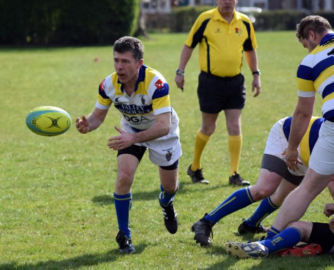 Nick Webb, scrum-half for Knutsford, passes to a teammate during his side's narrow 31-29 victory at Village Spartans in their final North West Intermediate League Division Three South fixture of the season. Picture: Tony Evans
