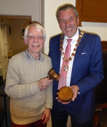 David Bryant presents the gavel to Cllr Coan