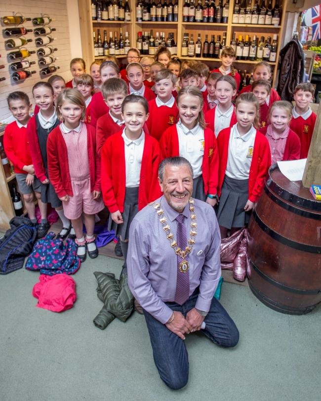 Town Mayor Cllr Peter Coan with the Egerton Primary School choir. Picture by Tatton Photography