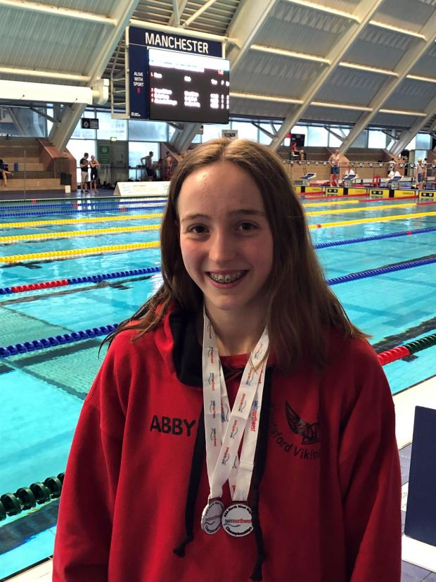 Knutsford Guardian: Abby Comline, from Knutsford Vikings, won two medals - one silver, the other bronze - during the Swim England North West Summer Championships at Manchester Aquatics Centre