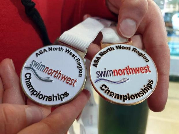 Knutsford Guardian: The medals, one silver and the other bronze, won by Knutsford Vikings member Abby Comline during the Swim England North West Summer Championships over three weekends of action at Manchester Aquatics Centre